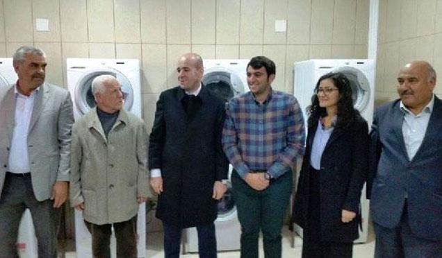 BM Kumlu'daki Suriyeliler için çamaşırhane kurdu